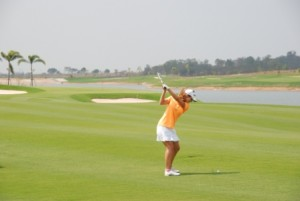 Beatriz Recari hits her approach shot to the opening hole at Siam Country Club's Waterside Course.