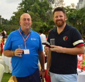 Dominic Wall (left) and Micah Woods (right) at a cocktail reception. Picture by Asian Turfgrass Centre.