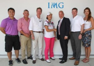 Lin Xiyu (fourth right) shakes hands with Guy Kinnings as IMG colleagues look on.