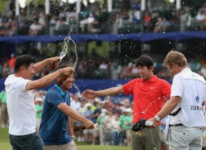 Charlie Wi and YE Yang ran onto the 18th green to celebrate Noh's breakthrough win. Picture by PGA Tour.