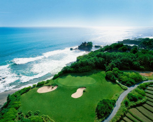 An arial view of Tanah Lot temple and the iconic seventh hole at Pan Pacific Nirwana Bali.