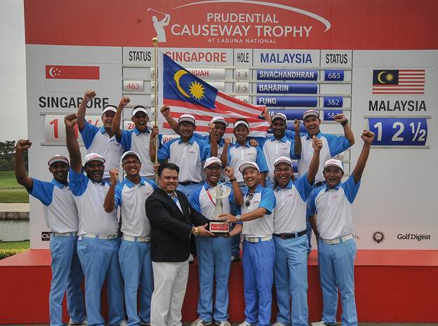 The Malaysian team celebrates its Causeway Trophy victory.