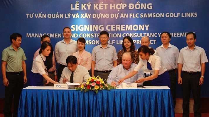 Martin Moore (front right) and FLC Group General Director Mr Phuong (front left) at the signing ceremony with FLC Group members and Flagstick Project Manager Marcus Reams (back row, third left).
