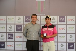 Putt Sridama receives his trophy from Angkor Golf Resort's David Baron after winning this year's Faldo Series Cambodia Championship.