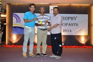 Tang Meng Loon [left] with Captain's Trophy winner Sallehudin bin Othman and Club Captain YBhg Dato' Setia Haji Mohd Adzib bin Mohd Isa.