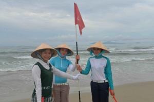 Caddies from Golf Coast Vietnam's three member clubs on My Khe beach.