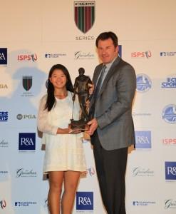 Megan Khang receives the 2013 Faldo Series trophy from Sir Nick Faldo.