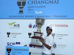 Rashid Khan poses with the trophy after winning the Chiangmai Golf Classic.