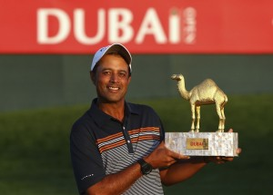 Arjun Atwal shows off the Dubai Open trophy.