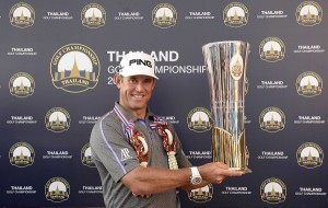 Lee Westwood shows off the Thailand Golf Championship trophy.
