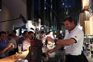 Nick Faldo gets to work behind the bar at Urban Fairways.
