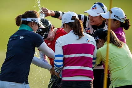 Kim Hyo-joo is congratulated by her Korean compatriots following her win at Mission Hills. Picture by Xaume Olleros/Power Sport Images