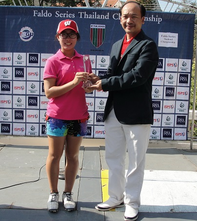 Bunyaporn Zeng is presented with her trophy by Pipoo Burapolpiman, General Manager of Panorama Golf and Country Club.