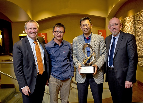 David Withers, President of Jacobsen, with Eddie Chan and Chandra Leo of  PT Sahabat Agritam, and Chuck Greif.