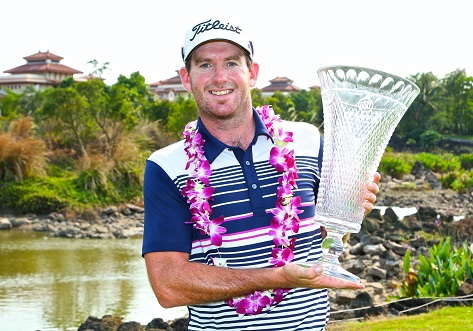 Josh Geary displays the winner's trophy at the Buick Open at Mission Hills Haikou. Picture by Liu Zhuang/COSI