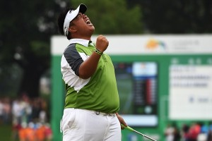 Kiradech celebrates after holing the winning putt. Picture by Getty Images.