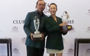 Chong Chee Huat and June Yap show off their trophies.