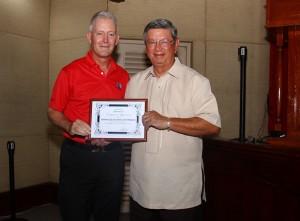 AGIF CEO Eric Lynge presents a token of appreciation to Orchard President Conrad Benitez.