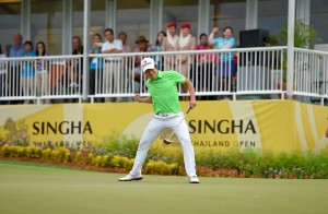 KT Kim celebrates his birdie putt on the 18th green.  Picture by Paul Lakatos/OneAsia.