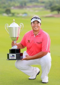 Kiradech Aphibarnrat shows off his latest piece of silverware.