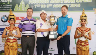 Ly Hong is presented with the Angkor Amateur Open trophy.