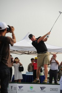 Ernie Els hits his first shot in Vietnam while visiting his latest project.