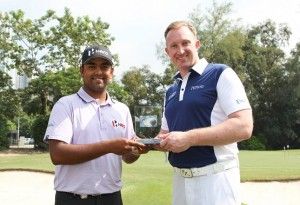Anirban Lahiri receives the Hilton Asian Tour Golfer of the Month trophy from Mark Liversidge.