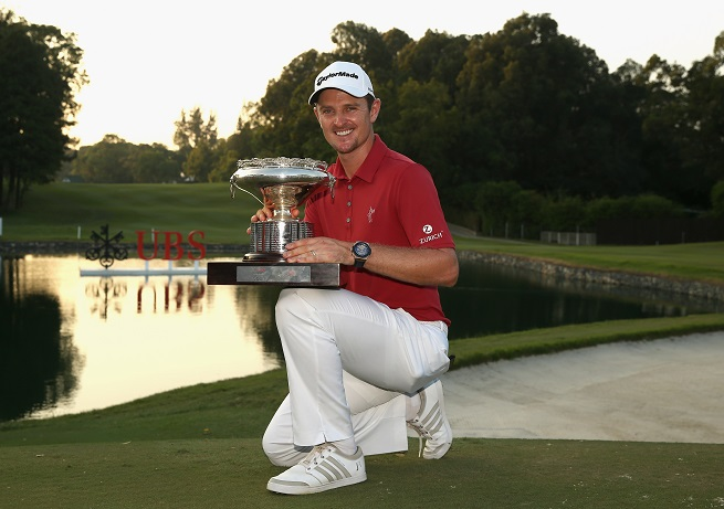 Justin Rose shows off the Hong Kong Open trophy. Picture by Ian Walton/Getty Images