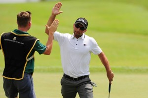 Josh Salah celebrates a final-round birdie with his caddie. Picture by Arep Kulal/PGM Tour /ADT