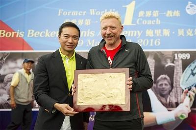 Boris Becker with Mission Hills Vice Chairman Tenniel Chu.