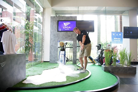 Ernie Els shows off his bunker skills at The Els Performance Golf Academy.
