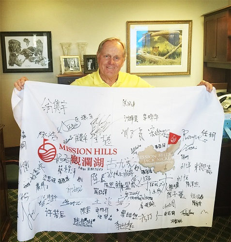 Jack Nicklaus holds a flag signed by competitors at last year's Jack Nicklaus Junior Championship.