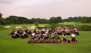 Othman and members of the golf course maintenance team at KLGCC.