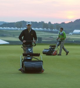 Oakmont Country Club maintenance crew members using Jacobsen PGM walking greens mower on an early morning mow ahead of this week's US Open.