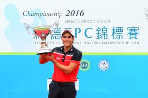 Carlos Pigem lifts the Yeangder TPC trophy.