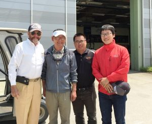 James Prusa (far left) with Yun Kyung-ho (second left), Jack Nicklaus Golf Club of Korea Superintendent, Jacobsen's Li Mengsheng (second right) and SKY72 Course Support Team Superintendent Hyun Cho.