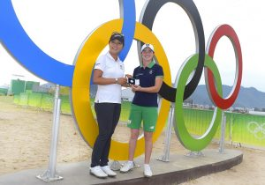 Leona Maguire receives her medal from Lydia Ko. Picture by Stan Badz/PGA Tour/IGF)