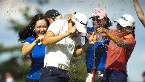 Seong is congratulated by friends after holing the winning putt. Picture by Steven Gibbons/USGA