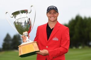 Alex Noren poses with the trophy following his extra-time victor. Picture by Ross Kinnaird/Getty Images