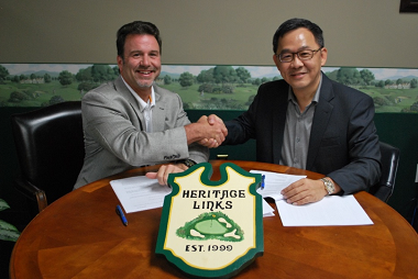 Heritage Links President Jon O'Donnell (left) signs a joint-venture agreement with MST Golf Chief Executive Ng Yap.