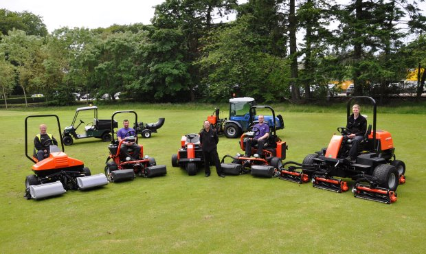 Stuart McBain (centre) with team members and a selection of recently purchased machinery from Jacobsen.