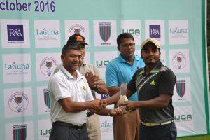 Mohd Rasel is congratulated by Brigadier General KM Salzar Hossain, Chairman, Tournament Committee, Army Golf Club.