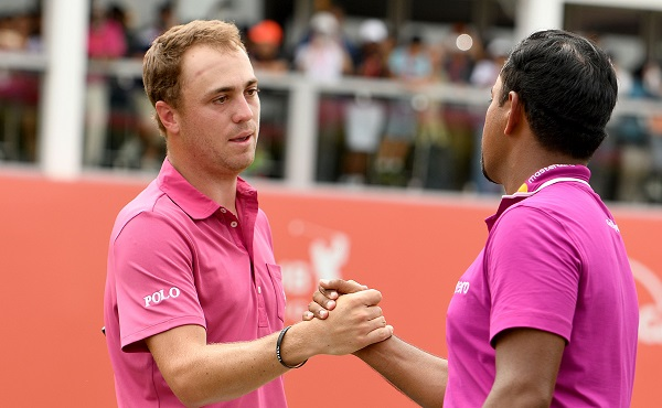 Justin Thomas and Anirban Lahiri shake hands at the conclusion of the CIMB Classic. Picture by Khalid Redza/ Asian Tour