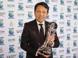 Tanes Petsuwan, Deputy Director, Tourism Authority of Thailand collects the award on behalf of Chiang Mai.