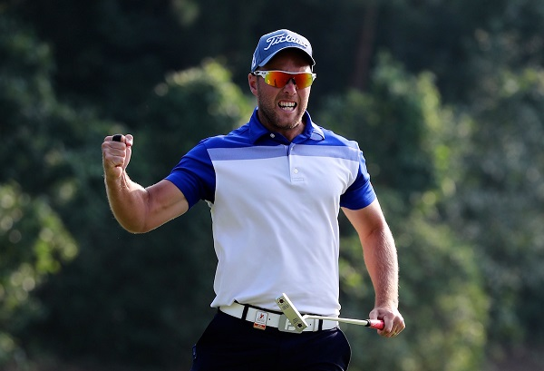 Daniel Nisbet celebrates after holing an eagle putt for victory at the first play-off hole.
