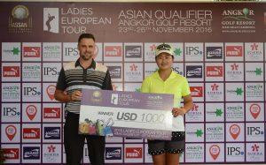 Angkor Golf Resort's Alan Martin congratulates Yan Liu on her success.