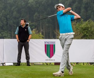 Watched by Sir Nick Faldo, Tom Parker tees-off at the 10th Faldo Series Asia Grand Final. Picture by Xaume Olleros.