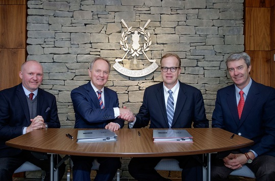 Euan Loudon (second left) and Richard Olson (second right) shake hands after signing the long-term agreement between St Andrews Links and Toro.