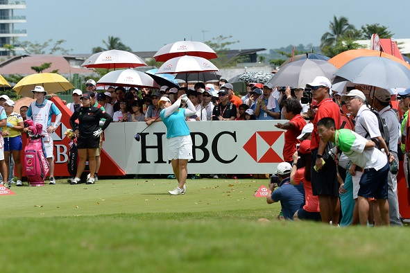 Large galleries followed Park In-bee around Sentosa's New Tanjong Course. Picture by Roslan Rahman/AFP/Getty Images)